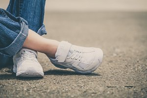 youth sneakers on girl legs