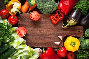 Fresh farmer vegetables at wooden table.