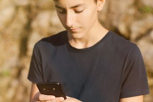 Teenager with mobile