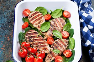 Grilled chicken fillet with tomatoes and spinach