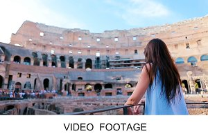 Young female looking at Colosseum