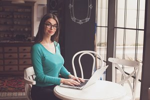Woman in glasses with laptop