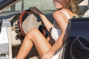 Pretty blond woman and luxury car