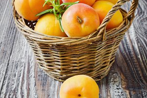 ripe apricots in a basket