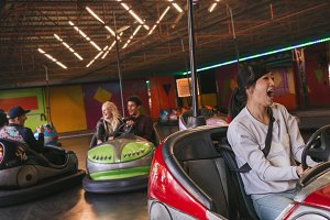 Friends having fun on bumper cars