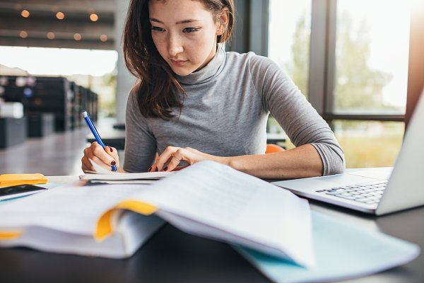 Education Stock Photos: Jacob Lund Photography - Student taking notes