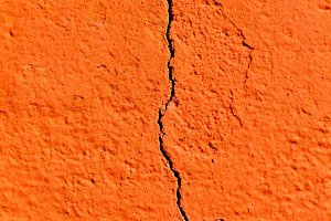 Surface of a red wall cracked