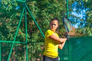 Pretty woman play tennis
