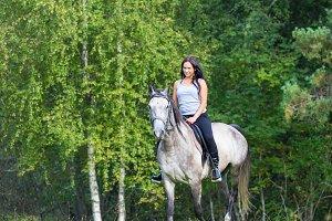 Elegant woman riding horse