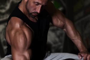 Training bodybuilder strong man arm workout