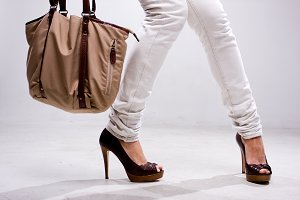 Legs of woman and bag