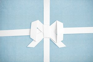 Blue paper and white ribbon with bow