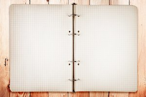 Open blank notebook on wood