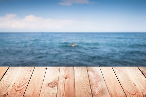 Empty wooden surface with blur sea