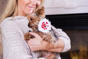woman yorkshire terrier fireplace