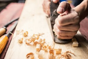 Man working with hand jack plane