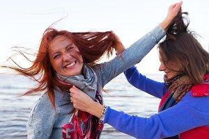 Fighting women near lake