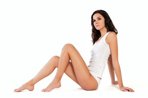 Young beautiful woman in cotton underwear on white isolated