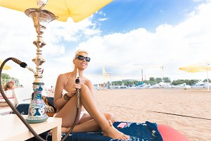 Woman with shisha on the beach
