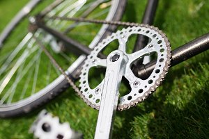 Classic road bicycle close-up photo in the summer green grass meadow field. Travel background