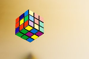 Six color cube puzzle on gold back