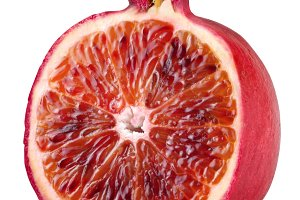 Red orange cut ripe pomegranate. Product of genetic engineering. Computer assembly.