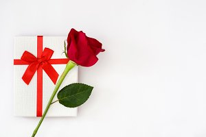 Gift box and red rose
