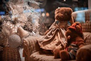 Toys sitting near Christmas tree