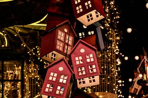 Glowing toy houses on Christmas tree