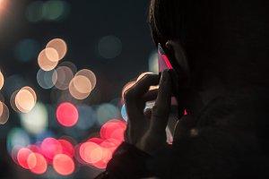 Man talking on mobile phone at night