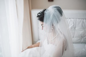 Beautiful European bridal couple in the hotel room