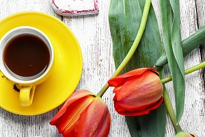 tea and bunch of tulips
