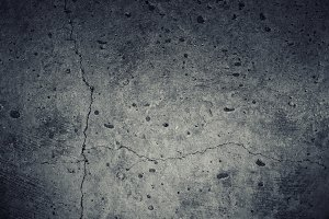 Concrete wall texture with cracks