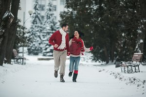 beautiful young couple running in the park