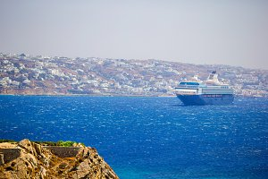 Beautiful landscape with sea view. Cruise liner at the sea near the islands. Mykonos island, Greece