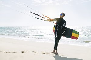 Portrait of kitesurfer in the beach.