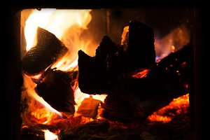 Fire and ashes in fireplace