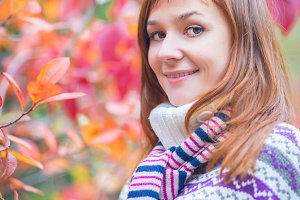 Pretty woman in an autumn park