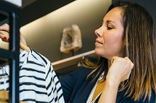 Woman looking at top in shop.