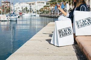 Shopping bags at sea front.