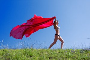 woman runing with red material