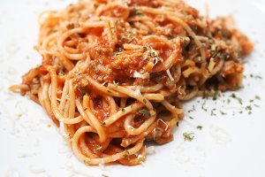 Close-up of spagetti on white dish - copy space