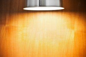 Spot light on wooden wall