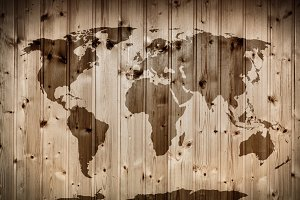 World map on wooden wall. Vintage