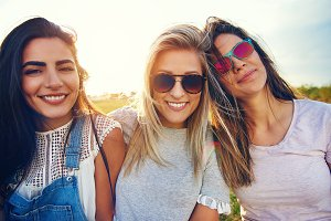 Three beautiful young women in sunglasses