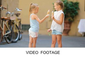 Cute kids enjoying ice-cream outdoor