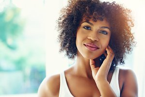 Pretty afro-american woman smiling at camera