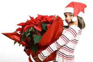 Funny girl with poinsettia
