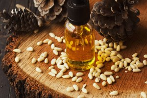 jar of oil pine nuts,, selective focus, space for text