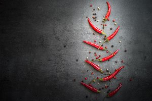 Rosemary, pepper and garlic on dark background